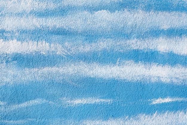 Mur de texture de fond blanc et bleu. stuc blanc en béton de ciment