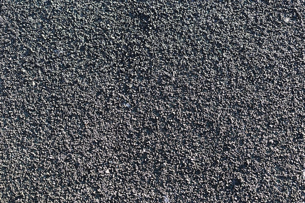 Mur de texture grungy gris foncé avec espace copie