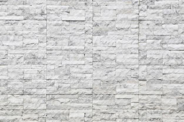 Mur de texture en marbre blanc de fond et motif de pierre.