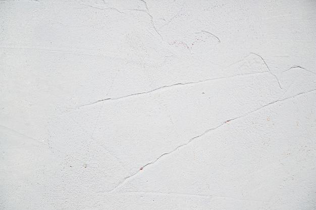 Mur texturé peint en blanc et vide