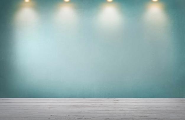 Mur vert avec une rangée de projecteurs dans une pièce vide