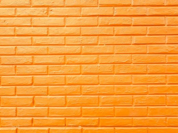 Murs de blocs de brique jaune, fond de texture de ciment jaune abstrait