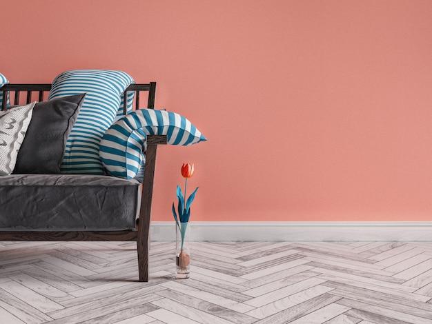 Murs orange sur le canapé gris.