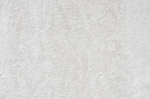 Murs de plâtre de style loft, gris, blanc, espace vide utilisé comme papier peint.