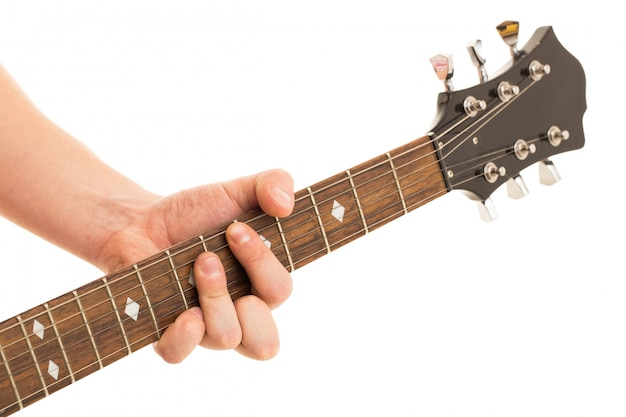 Musique, gros plan musicien tenant une guitare électro