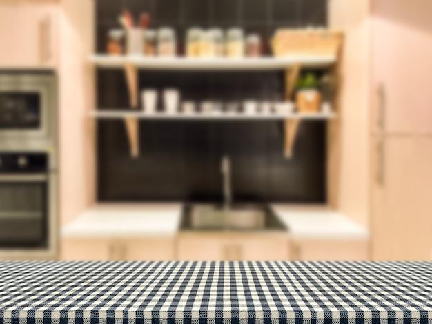 Nappe à carreaux avec fond d'armoires de cuisine