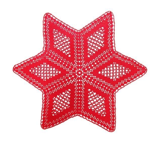Napperon au crochet ajouré, l'étoile de noël, isolé sur blanc
