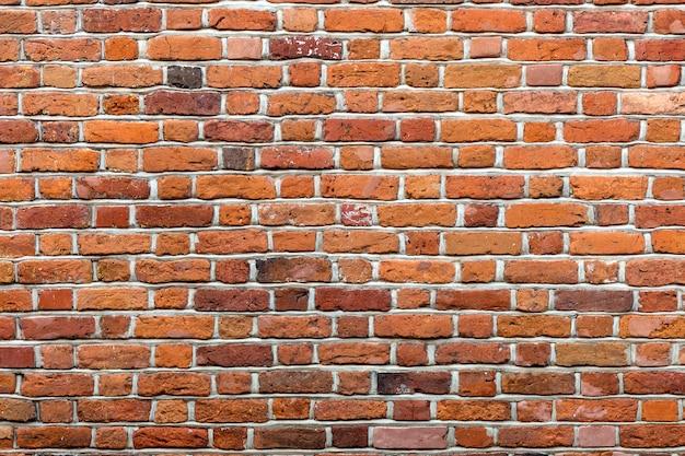 Naturel vieux millésime altéré mur de briques solides brun rouge.
