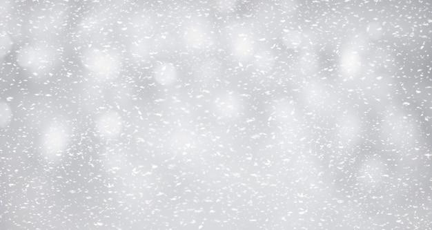 Neige sur fond argenté. idée de concept d'hiver et de noël.