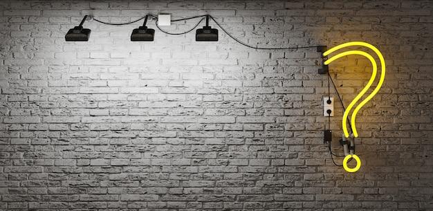 Néon avec point d'interrogation jaune sur mur de briques grises avec zone de projecteur