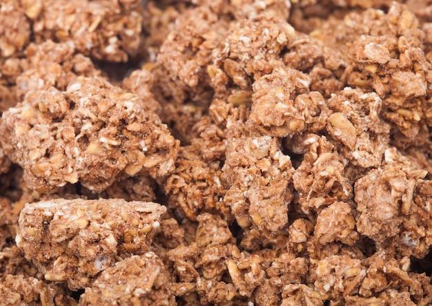 Nic flocons de céréales granola frais avec macro texture chocolat