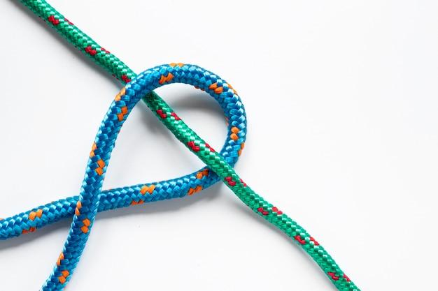 Noeud de corde de marin vert et bleu