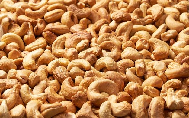 Noix de cajou grillées, texture et fond. délicieuses noix de cajou comme toile de fond, texture des noix de cajou. pose à plat