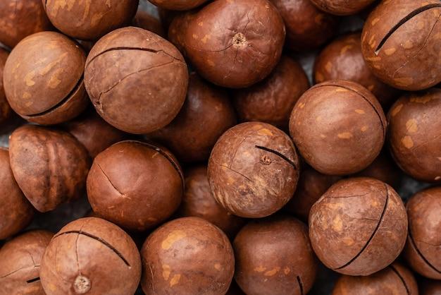 Noix de macadamia se bouchent. petit déjeuner, nourriture saine. il peut être utilisé comme arrière-plan