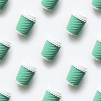 De nombreuses tasses de café vertes comme modèle sans couture