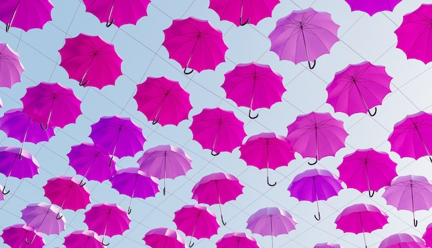 De nombreux parapluies roses suspendus dans la rue avec un ciel ensoleillé. rendu 3d