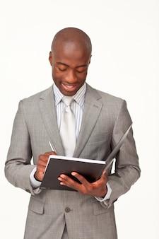 Notes d'écriture de l'homme d'affaires attrayant
