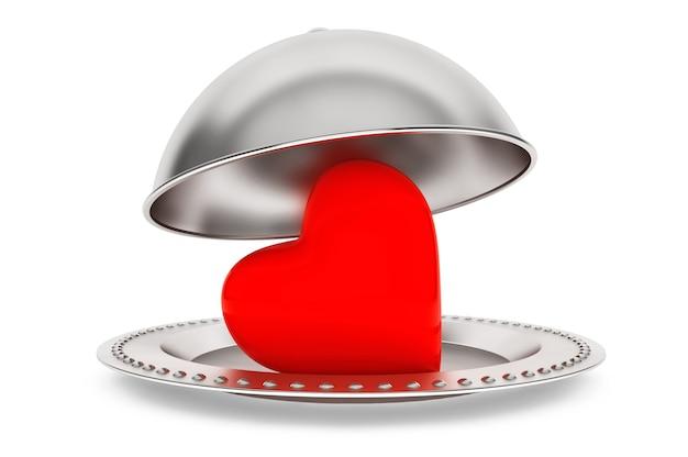 Notion d'amour. cloche de restaurant d'argent avec coeur sur fond blanc