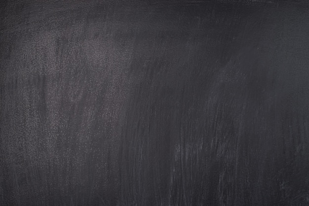 Notion d'école. photo en gros plan d'un tableau noir taché