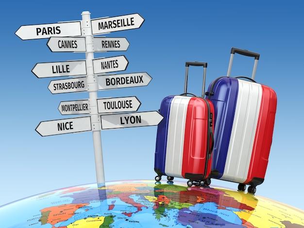 Notion de voyage. valises et panneau que visiter en france. 3d