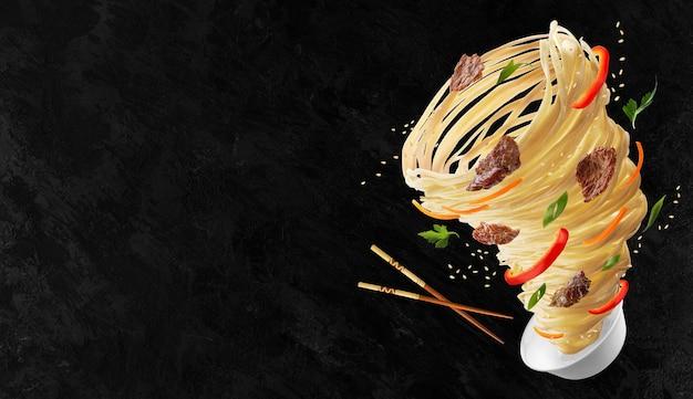 Nouilles aux légumes et à la viande sous la forme d'une tornade. bâtonnets de bois et bol de nouilles, poivrons rouges, carottes, oignons et viande. espace de copie.