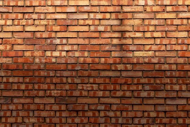 Nouveau mur de briques de texture rapprochée de briques rouges.