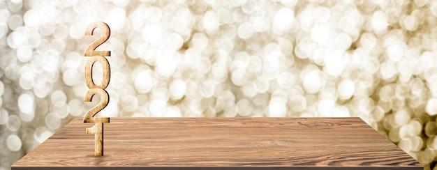 Nouvel an 2021 numéro de bois blanc sur table en bois à flou abstrait bokeh or