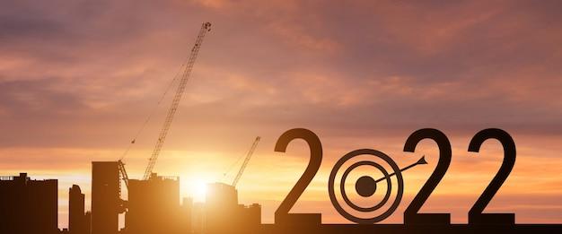 Nouvel an 2022 avec un objectif de réussite silhouette. concept de démarrage.