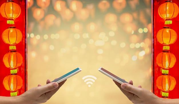 Le nouvel an chinois, digital hongbao ou enveloppe rouge envoient sur téléphone portable.