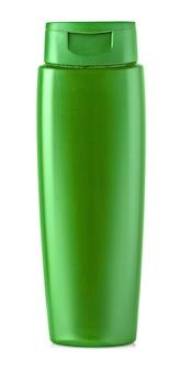 Nouvelle bouteille de shampoing vert. isolé sur blanc.