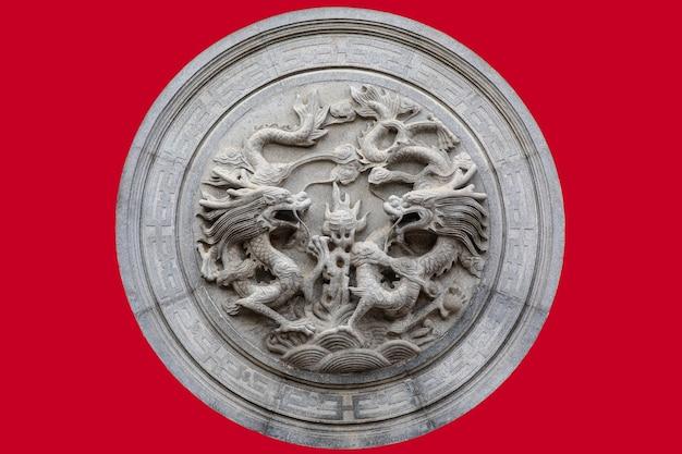 Nuage de pédales de statue de deux dragons sur fond rouge