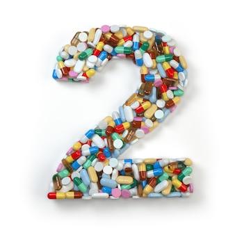 Numéro 2 deux des comprimés de capsules de pilules de médecine et de boursouflures d'isolement sur le blanc