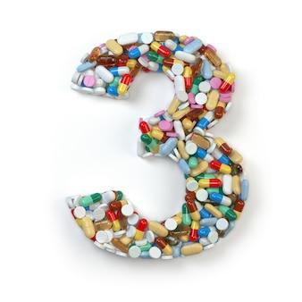 Numéro 3 trois de comprimés de comprimés de capsules de pilules de médecine et de boursouflures d'isolement sur le blanc