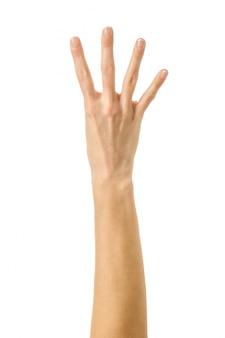 Numéro quatre. main de femme gesticulant isolé sur blanc