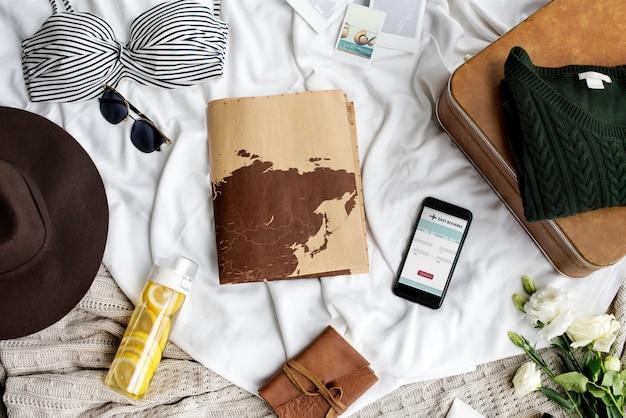 Objets de voyage sur le lit