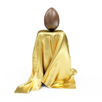 Oeuf de pâques en chocolat sur support recouvert de tissu doré isolé