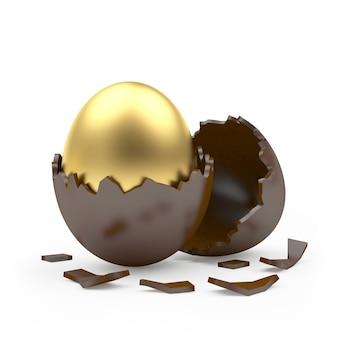 Oeuf de pâques doré dans une coquille d'oeuf en chocolat