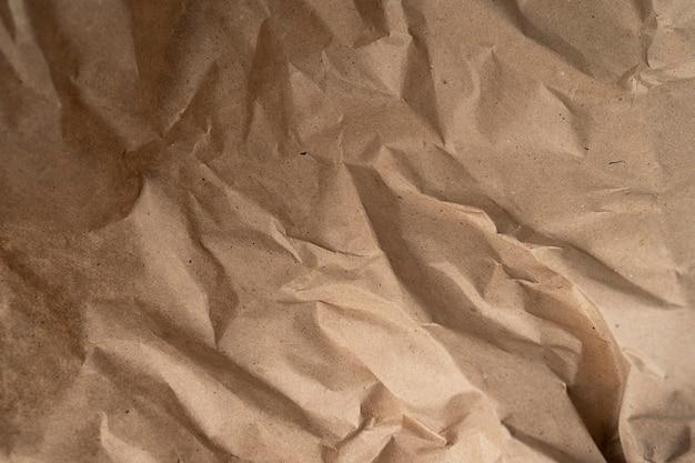 Old Beige Eco Papier Froissé Texture De Fond Kraft, Concept Pour La Conception De Papier Peint De Page, Motif Organique Beige Pour Mur Décoratif. Décoration Vintage Pour Le Fond Photo Premium