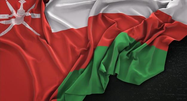 Oman flag enroulé sur fond sombre 3d render