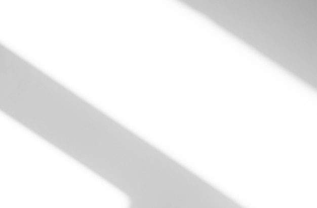 Ombres abstraites douces et silhouettes de lignes sur le mur comme texture ou arrière-plan