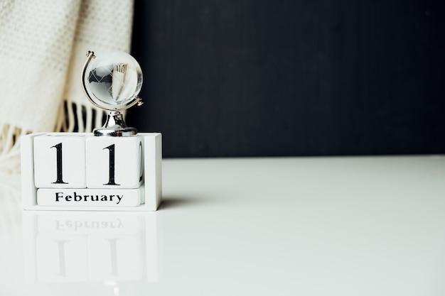 Onzième jour du calendrier du mois d'hiver février avec espace de copie.