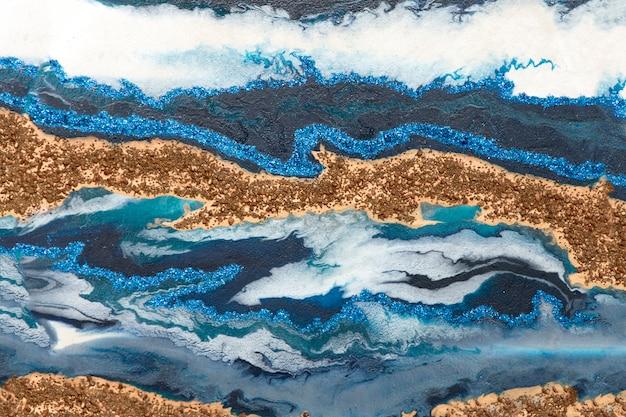 Or, bleu, blanc, texture ondulée brillante.