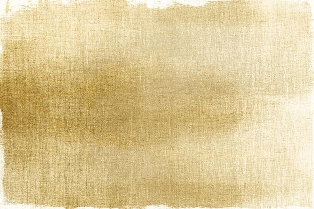 Or peint sur un fond texturé en tissu