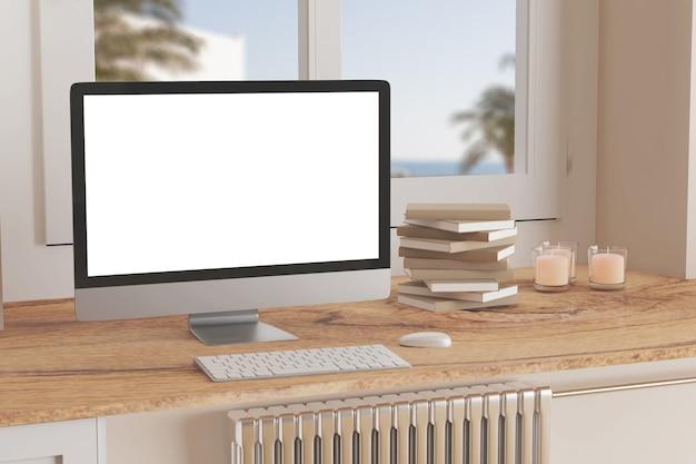 Ordinateur de bureau vierge avec clavier sur table à fenêtre livres sur table en marbre dans une pièce ensoleillée