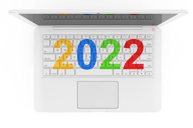Ordinateur portable blanc avec signe du nouvel an 2022 sur fond blanc. rendu 3d
