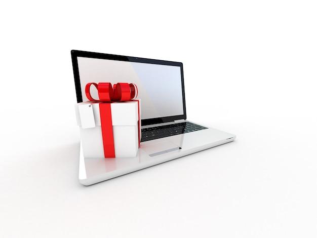 Ordinateur portable et cadeaux sur blanc