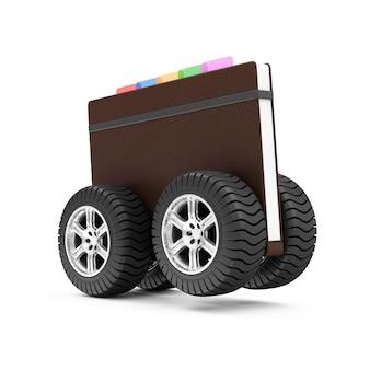 Ordinateur portable avec couverture en cuir sur roues isolé sur fond blanc