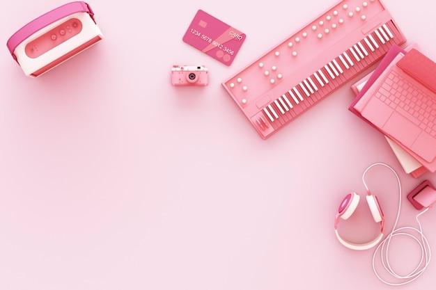 Ordinateur portable entouré de gadgets colorés sur le rendu 3d rose