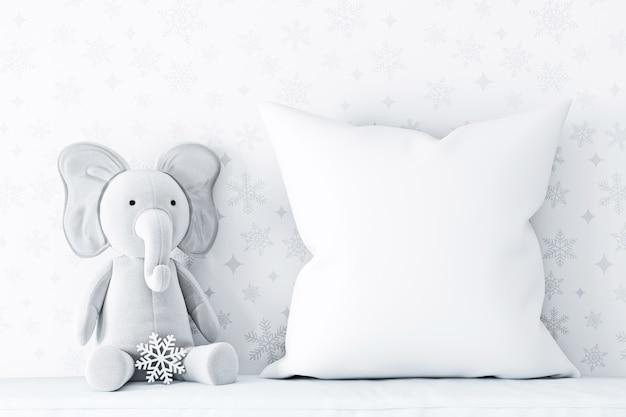 Oreiller blanc avec éléphant d'hiver sur canapé