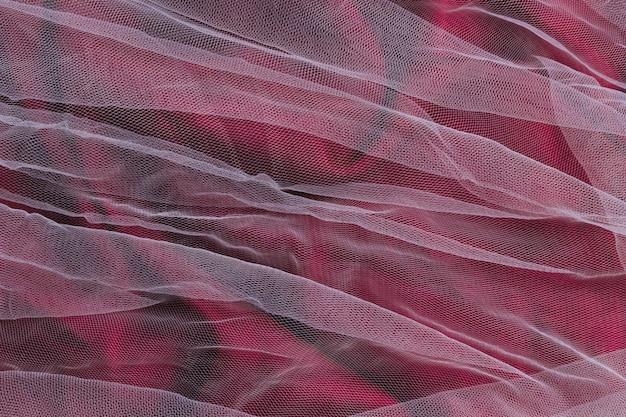 Ornement violet et transparent à l'intérieur du tissu de décoration
